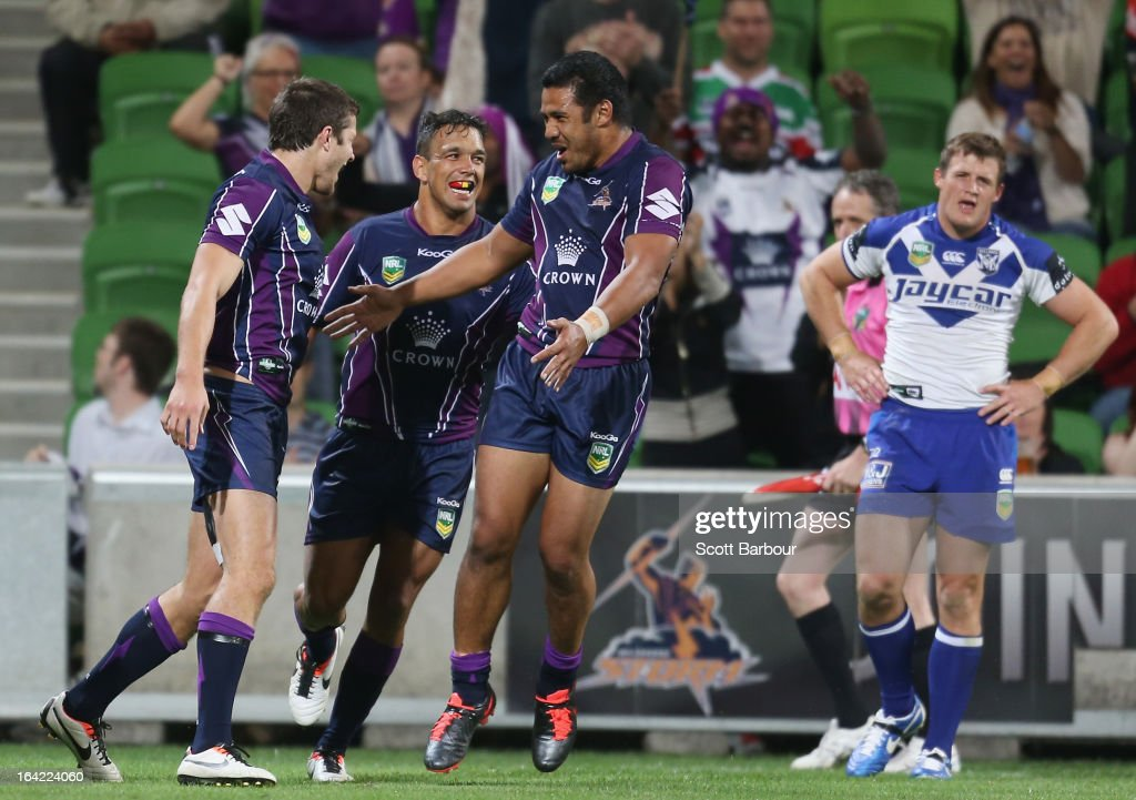 Matt Duffie (L) of the Storm is congratulated by his team mates after scoring a try during the round three NRL match between the Melbourne Storm and the Canterbury Bulldogs at AAMI Park on March 21, 2013 in Melbourne, Australia.