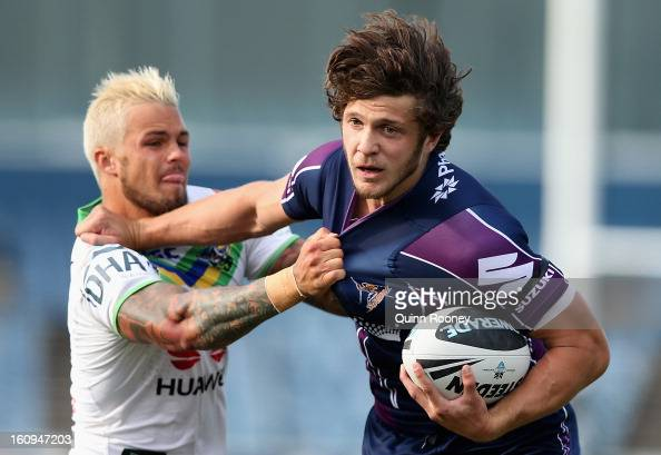 Matt Duffie of the Storm is tackled by Sandor Earl of the Raiders during the NRL trial match between the Melbourne Storm and the Canberra Raiders at...