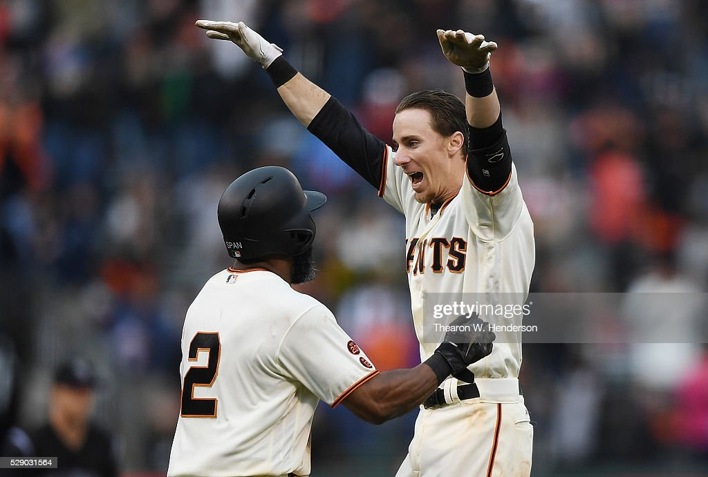 Matt Duffy #5 and Denard Span #2 of the San Francisco Giants celebrates after Duffy hit a walk off game winning rbi single scoring Conor Gillaspie #21 against the Colorado Rockies in the bottom of the 13th inning at AT&T Park on May 7, 2016 in San Francisco, California. The Giants won the game 2-1.