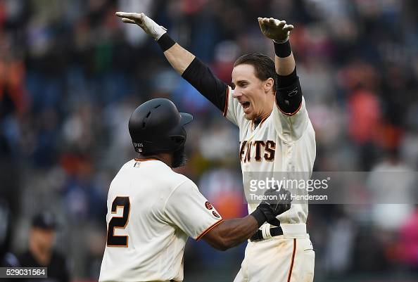 Matt Duffy and Denard Span of the San Francisco Giants celebrates after Duffy hit a walk off game winning rbi single scoring Conor Gillaspie against...
