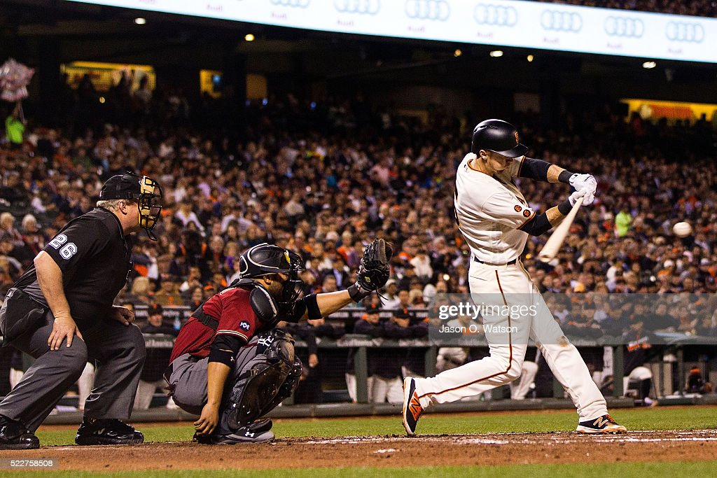 Matt Duffy #5 of the San Francisco Giants hits a double in front of <a gi-track='captionPersonalityLinkClicked' href=/galleries/search?phrase=Welington+Castillo&family=editorial&specificpeople=4959193 ng-click='$event.stopPropagation()'>Welington Castillo</a> #7 of the Arizona Diamondbacks and umpire Bill Miller #26 during the fourth inning at AT&T Park on April 20, 2016 in San Francisco, California.