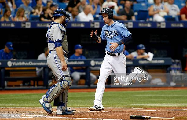 Matt Duffy of the Tampa Bay Rays runs home ahead of catcher Russell Martin of the Toronto Blue Jays to score off of an RBI single by Corey Dickerson...
