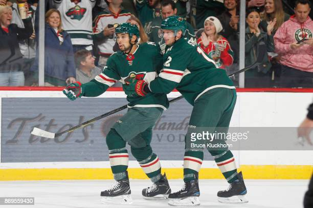 Matt Dumba and Eric Staal of the Minnesota Wild celebrate after scoring a goal against the Montreal Canadiens during the game at the Xcel Energy...