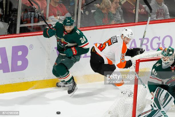 Matt Dumba of the Minnesota Wild and Jori Lehtera of the Philadelphia Flyers battle for the puck during the game at the Xcel Energy Center on...