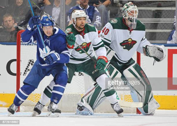 Matt Dumba of the Minnesota Wild battles against Mitchell Marner of the Toronto Maple Leafs during an NHL game at the Air Canada Centre on November 8...