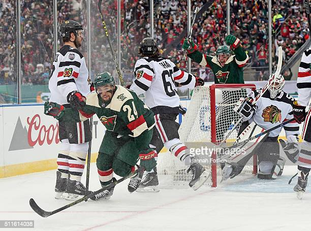 Matt Dumba of the Minnesota Wild celebrates his goal along with Ryan Carter at 325 of the first period against Corey Crawford of the Chicago at the...
