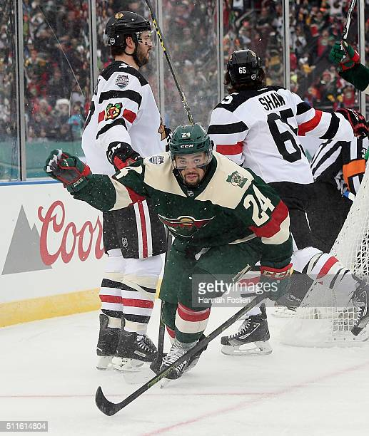 Matt Dumba of the Minnesota Wild celebrates his goal at 325 of the first period against the Chicago Blackhawks at the TCF Bank Stadium during the...