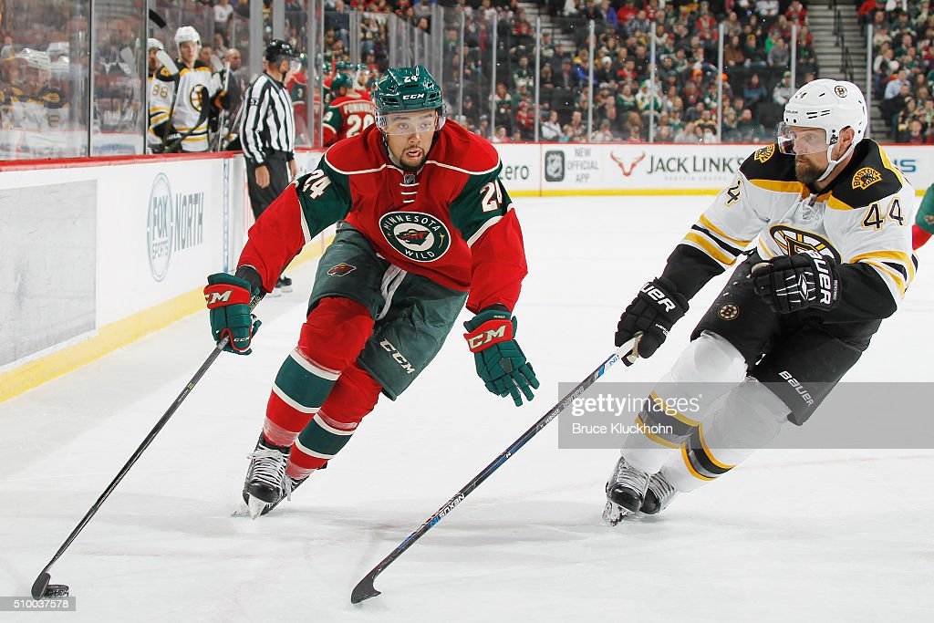 Matt Dumba #24 of the Minnesota Wild skates with the puck while <a gi-track='captionPersonalityLinkClicked' href=/galleries/search?phrase=Dennis+Seidenberg&family=editorial&specificpeople=204616 ng-click='$event.stopPropagation()'>Dennis Seidenberg</a> #44 of the Boston Bruins defends during the game on February 13, 2016 at the Xcel Energy Center in St. Paul, Minnesota.