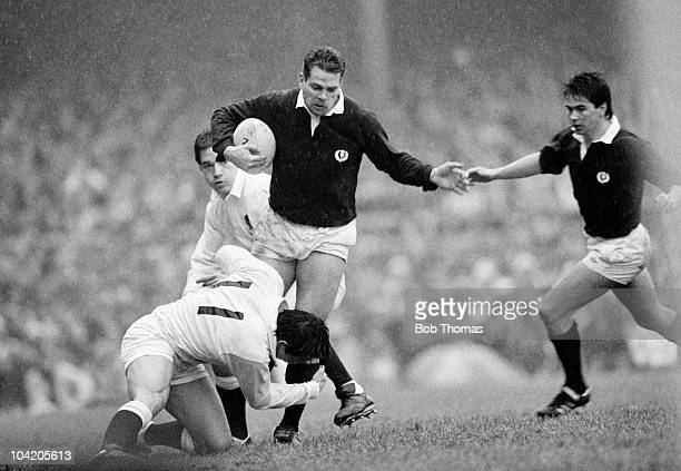 Matt Duncan of Scotland is tackled by Rory Underwood of England during the England v Scotland Rugby Union International match played at Twickenham on...