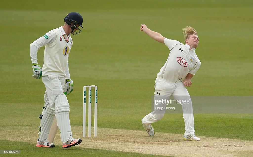 Matt Dunn of Surrey bowls during day two of the Specsavers County Championship Division One match between Surrey and Durham at the Kia Oval on May 2, 2016 in London, England.