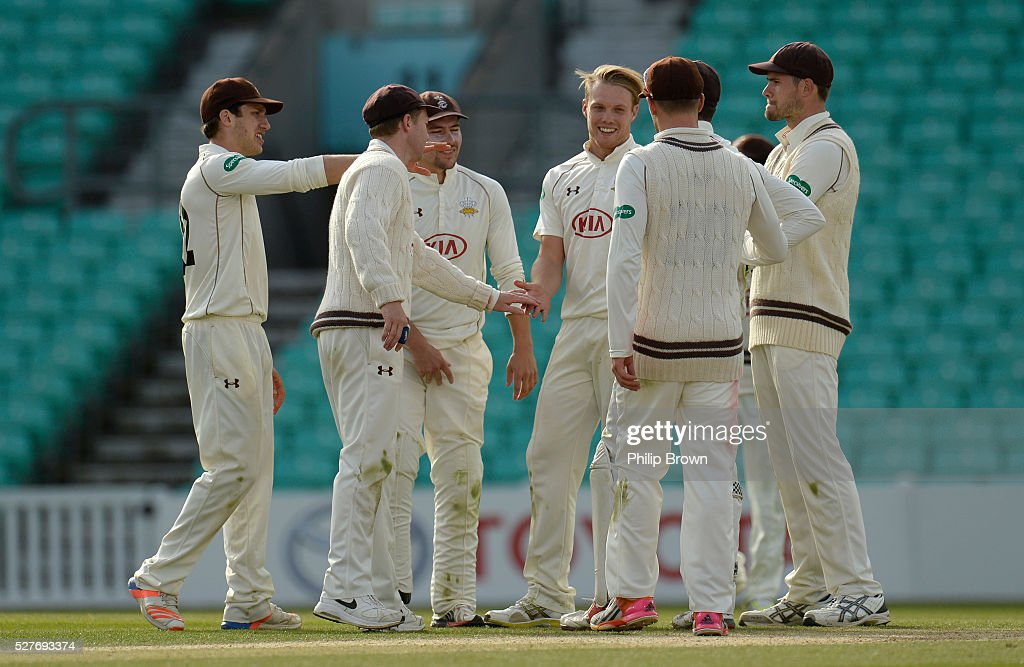 Matt Dunn of Surrey celebrates after dismissing Michael Richardson of Durham during day three of the Specsavers County Championship Division One match between Surrey and Durham at the Kia Oval on May 3, 2016 in London, England.