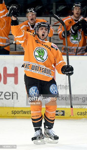 Matt Dzieduszycki of Wolfsburg celebrates after scoring his team's third goal during game three of the DEL preplayoffs between Thomas Sabo Ice Tigers...