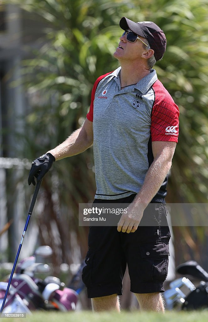 Matt Elliott, Coach of the Warriors watches his ball after teeing off during a New Zealand Warriors NRL golf day at Titirangi Golf Club on February 19, 2013 in Auckland, New Zealand.