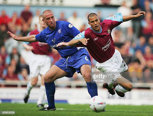 Matt Elliott of Ipswich Town battles with Bobby Zamora of West Ham United during the Nationwide Division One Playoff Second Leg match between West...