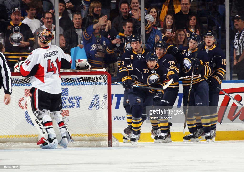 Matt Ellis #37 of the Buffalo Sabres celebrates his goal at 2:25 of the first period against <a gi-track='captionPersonalityLinkClicked' href=/galleries/search?phrase=Craig+Anderson&family=editorial&specificpeople=211238 ng-click='$event.stopPropagation()'>Craig Anderson</a> #41 of the Ottawa Senators at the First Niagara Center on November 11, 2011 in Buffalo, New York.