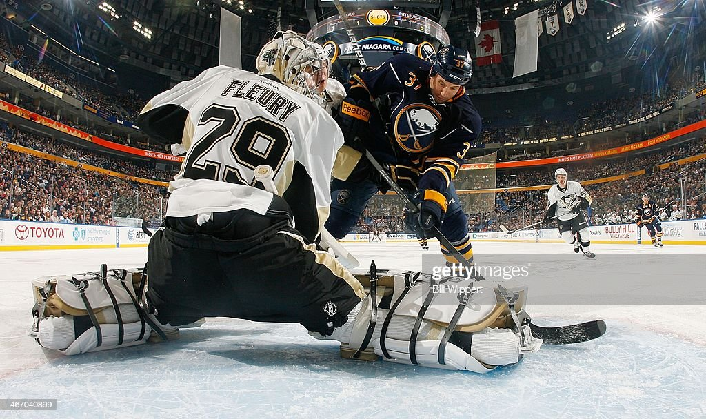 Matt Ellis #37 of the Buffalo Sabres is stopped on a first period shot by Marc-Andre Fleury #29 of the Pittsburgh Penguins on February 5, 2014 at the First Niagara Center in Buffalo, New York.