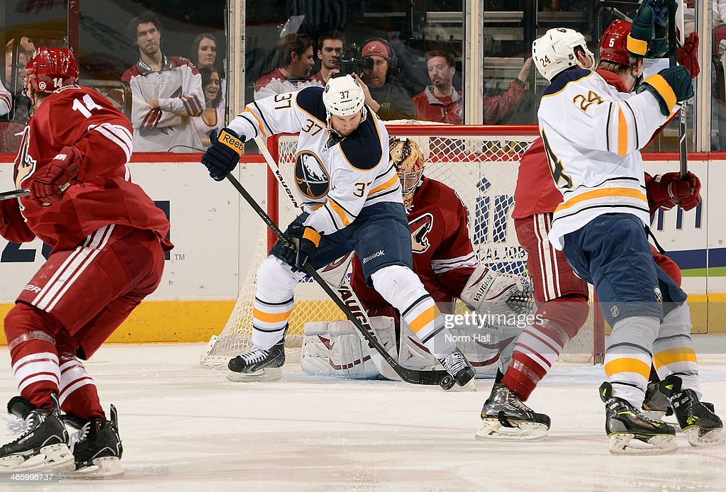 Matt Ellis #37 of the Buffalo Sabres tries to get a shot past goaltender <a gi-track='captionPersonalityLinkClicked' href=/galleries/search?phrase=Thomas+Greiss&family=editorial&specificpeople=695275 ng-click='$event.stopPropagation()'>Thomas Greiss</a> #1 of the Phoenix Coyotes during the second period at Jobing.com Arena on January 30, 2014 in Glendale, Arizona.