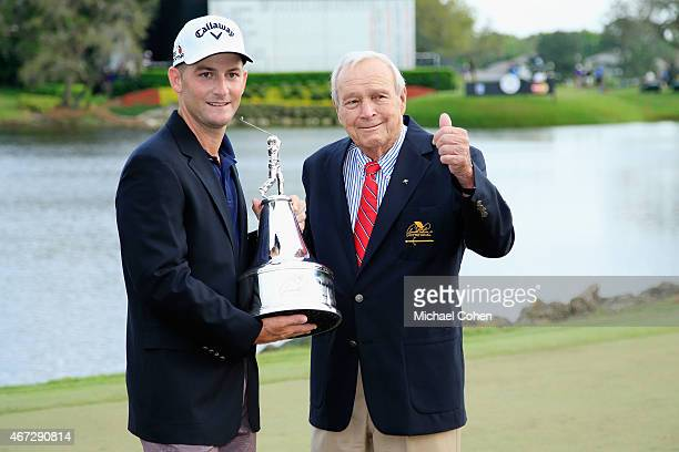 Matt Every of the United States celebrates with the championship trophy alongside Arnold Palmer after winning the final round of the Arnold Palmer...