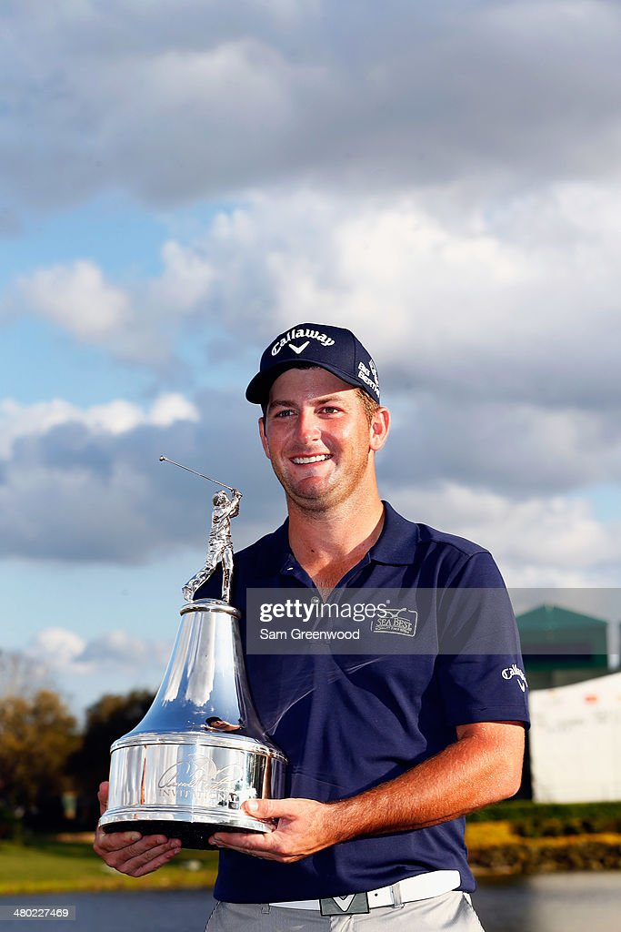 Matt Every of the United States celebrates with the trophy after winning the Arnold Palmer Invitational presented by MasterCard at the Bay Hill Club and Lodge on March 23, 2014 in Orlando, Florida.
