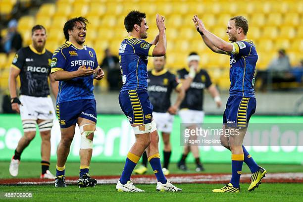 Matt Faddes of Otago celebrates his try with Adam Knight and Aki Seiuli during the round six ITM Cup match between Wellington and Otago at Westpac...
