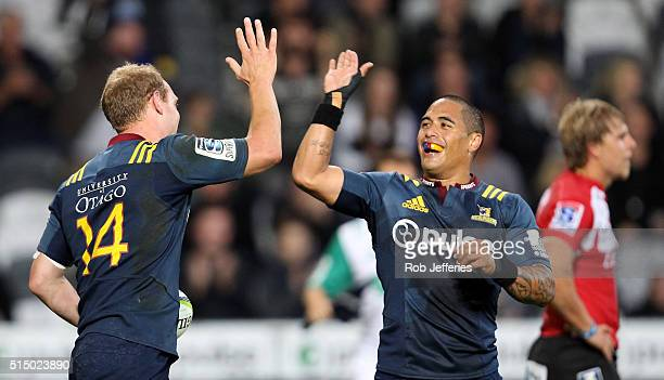 Matt Faddes of the Highlanders celebrates his try with Aaron Smith during the round three Super Rugby match between the Highlanders and the Lions at...
