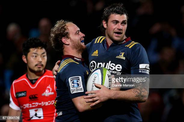Matt Faddes of the Highlanders celebrates his try with team mate Liam Squire during the round nine Super Rugby match between the Highlanders and the...