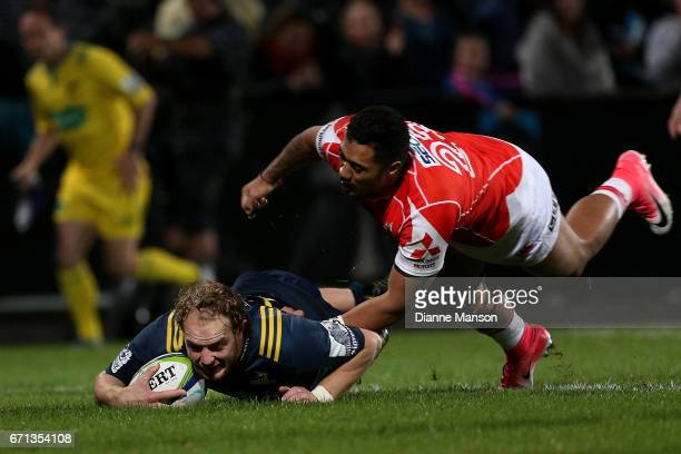 Matt Faddes of the Highlanders dives over to score a try during the round nine Super Rugby match between the Highlanders and the Sunwolves at Rugby...