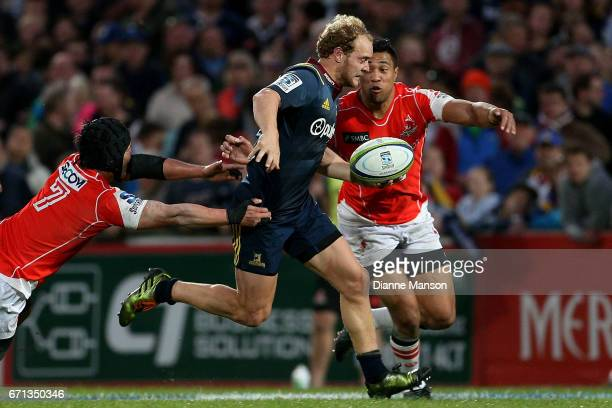 Matt Faddes of the Highlanders fends off Yuhimaru Mimura of the Sunwolves during the round nine Super Rugby match between the Highlanders and the...