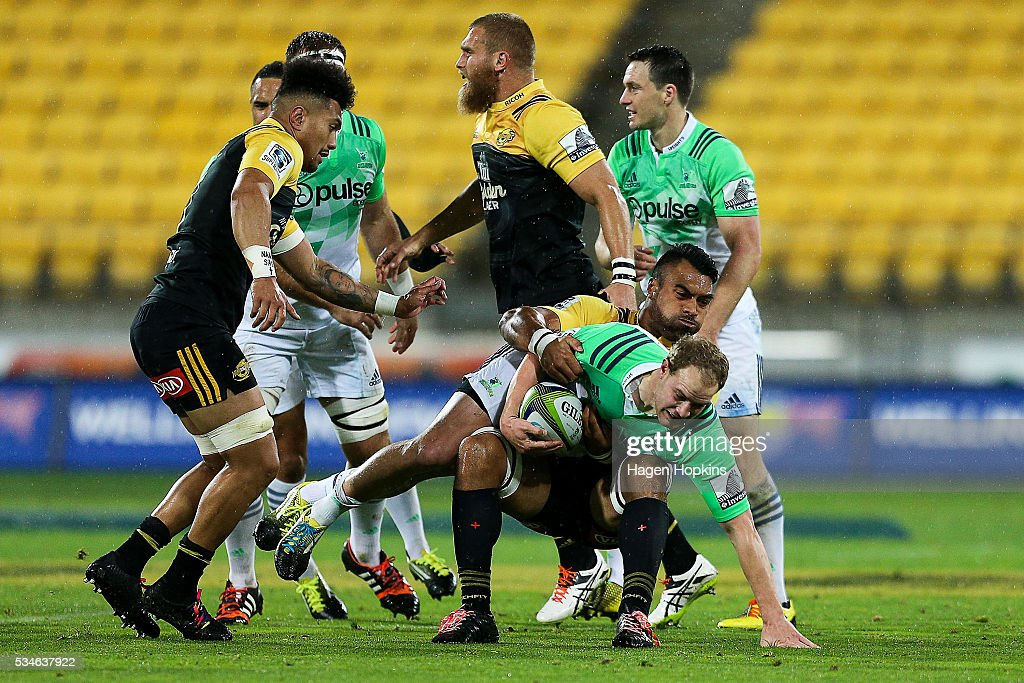 Matt Faddes of the Highlanders is tackled by Victor Vito of the Hurricanes during the round 14 Super Rugby match between the Hurricanes and the Highlanders at Westpac Stadium on May 27, 2016 in Wellington, New Zealand.
