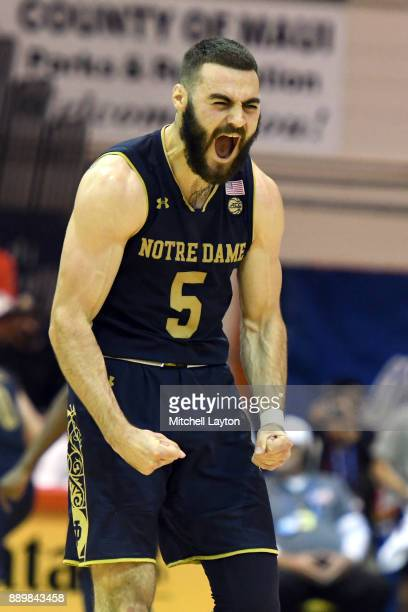 Matt Farrell of the Notre Dame Fighting Irish celebrates a shot during a semifinal college basketball game at the Maui Invitational against the LSU...