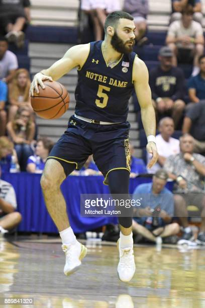 Matt Farrell of the Notre Dame Fighting Irish dribbles the ball during a semifinal college basketball game at the Maui Invitational against the LSU...