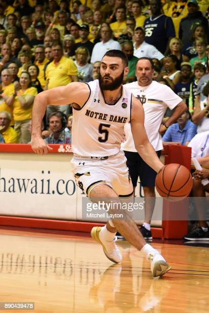 Matt Farrell of the Notre Dame Fighting Irish dribbles the ball during a the championship of the Maui Invitational college basketball game against...