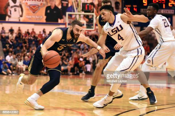Matt Farrell of the Notre Dame Fighting Irish dribbles the ball around Skylar Mays of the LSU Tigers during a semifinal college basketball game at...