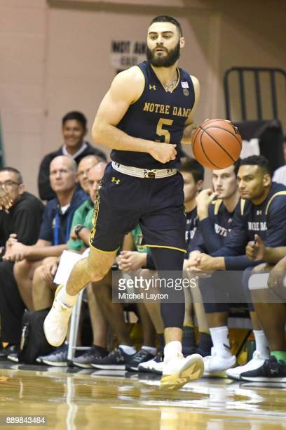 Matt Farrell of the Notre Dame Fighting Irish dribbles the ball up courtl during a semifinal college basketball game at the Maui Invitational against...