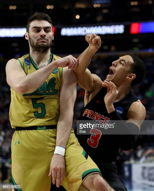 Matt Farrell of the Notre Dame Fighting Irish fouls Devin Cannady of the Princeton Tigers during the second half during the first round of the 2017...