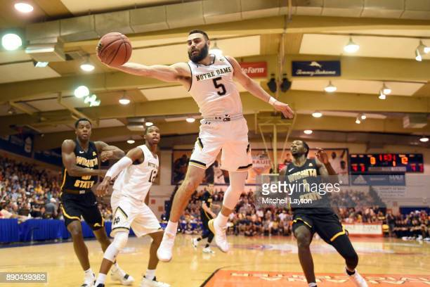 Matt Farrell of the Notre Dame Fighting Irish keeps the ball in bounds during a the championship of the Maui Invitational college basketball game...