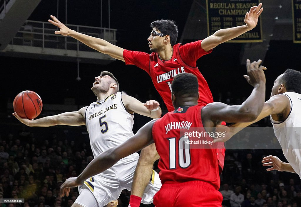 Matt Farrell #5 of the Notre Dame Fighting Irish shoots the ball as Anas Mahmoud #14 of the Louisville Cardinals defends over the top at Purcell Pavilion on January 4, 2017 in South Bend, Indiana.