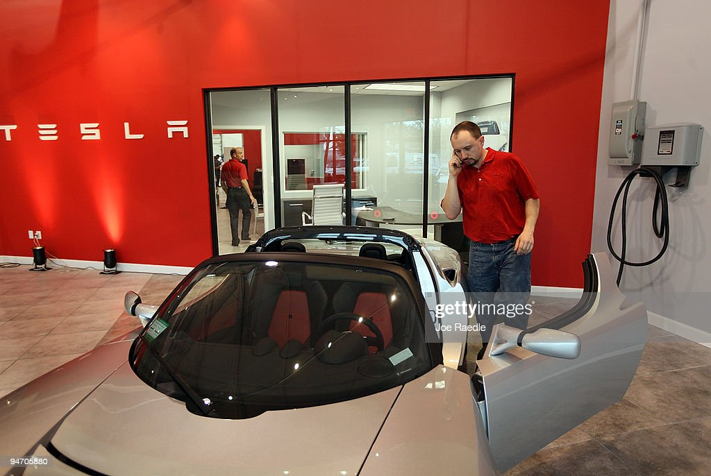 Matt Farrell prepares to move the Roadster Sport to another spot on the floor at the Tesla Motors first South Florida location on December 17, 2009 in Dania Beach, Florida. Tesla produces high-performance electric vehicles with a fully electric power train.