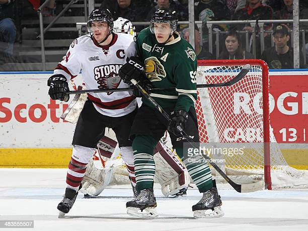 Matt Finn of the Guelph Storm ties up Bo Horvat of the London Knights in Game Three of the OHL Western Conference SemiFinal at the Budweiser Gardens...