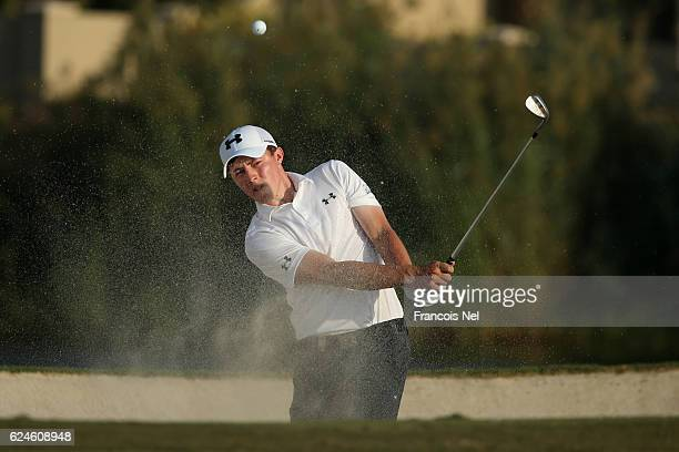 Matt Fitzpatrick of England hits from a bunker on the 17th hole during day four of the DP World Tour Championship at Jumeirah Golf Estates on...