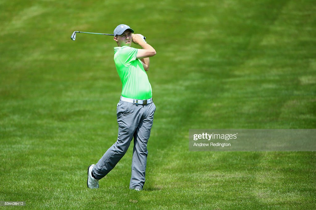 Matt Fitzpatrick of England hits his 2nd shot on the 4th hole during day one of the BMW PGA Championship at Wentworth on May 26, 2016 in Virginia Water, England.