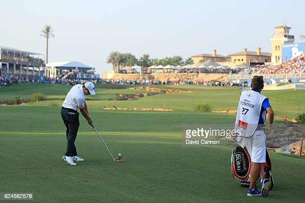 Matt Fitzpatrick of England hits his second shot on the 18th hole during day four of the DP World Tour Championship at Jumeirah Golf Estates on...