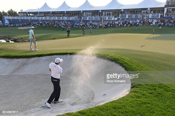 Matt Fitzpatrick of England hits his third shot on the 18th hole during day four of the DP World Tour Championship at Jumeirah Golf Estates on...