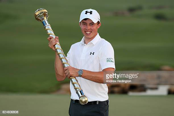 Matt Fitzpatrick of England poses with the trophy following his victory during day four of the DP World Tour Championship at Jumeirah Golf Estates on...
