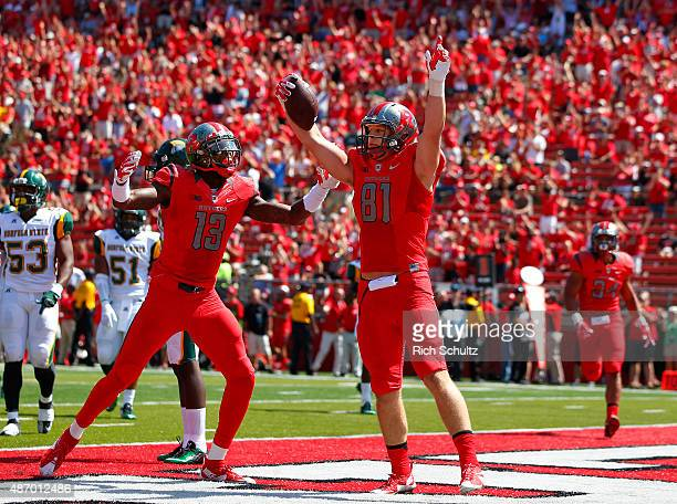 Matt Flanagan of the Rutgers Scarlet Knights celebrates his touch down with teammate Carlton Agudosi during the first half against the Norfolk State...