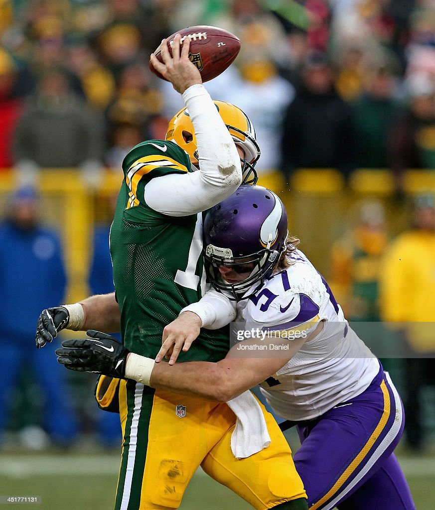 Matt Flynn #10 of the Green Bay Packers is hit while passing by <a gi-track='captionPersonalityLinkClicked' href=/galleries/search?phrase=Audie+Cole&family=editorial&specificpeople=6232608 ng-click='$event.stopPropagation()'>Audie Cole</a> #57 of the Minnesota Vikings at Lambeau Field on November 24, 2013 in Green Bay, Wisconsin. The Vikings and the Packers tied 26-26 after overtime.