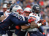 Matt Fort of the Chicago Bears is tackled by Patrick Chung of the New England Patriots during the first quarter at Gillette Stadium on October 26...