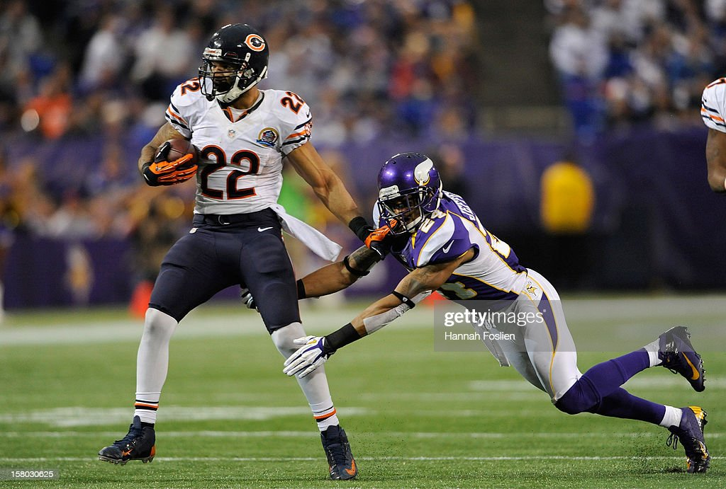 Matt Forte #22 of the Chicago Bears avoids a tackle by A.J. Jefferson #24 of the Minnesota Vikings during the third quarter of the game on December 9, 2012 at Mall of America Field at the Hubert H. Humphrey Metrodome in Minneapolis, Minnesota. The Vikings defeated the Bears 21-14.