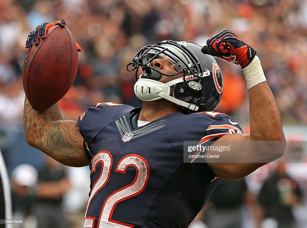 Matt Forte #22 of the Chicago Bears celebrates a touchdown run against the Cincinnati Bengals at Soldier Field on September 8, 2013 in Chicago, Illinois. The Bears defeated the Bengals 24-21.