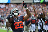 Matt Forte of the Chicago Bears celebrates after scoring a touchdown in the second quarter against the Green Bay Packers at Soldier Field on...